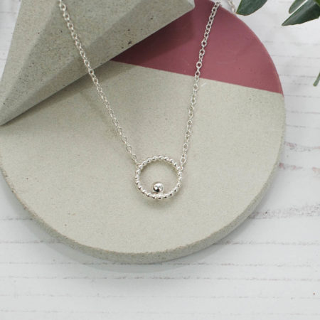 Small circle and bead silver necklace polished lifestyle shot