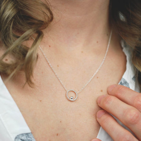 Small circle and bead silver necklace polished worn by model